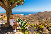 Spain, Canary Islands, Lanzarote, Maguez, near Haria, woman looking out on the sea