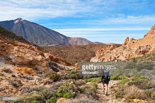 Spain, Canary Islands, Tenerife, Roques de Garcia, Mount Teide, Teide National Park, Female hiker in the Caldera de las Canadas