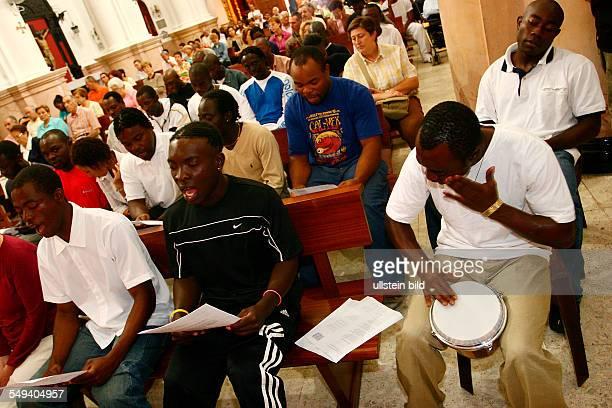 Service in the church called Santa Maria de Africa Singing visitors