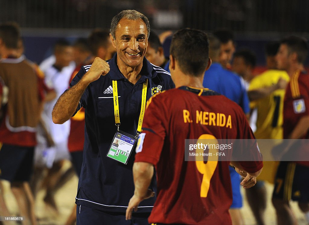 Spain coach Joaquin Alonso celebrates with Raul Merida at the end of the FIFA Beach Soccer World Cup Tahiti 2013 Quarter Final match between Spain and El Salvador on at the Tahua To'ata Stadium on September 25, 2013 in Papeete, French Polynesia.