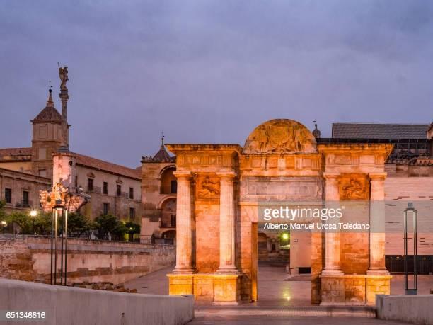 Spain, Cordoba, Gate of the Roman Bridge and cityscape.