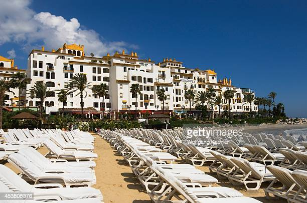 Spain Costa Del Sol Marbella Puerto Banus Beach With Sunchairs Hotel Benabola In Background