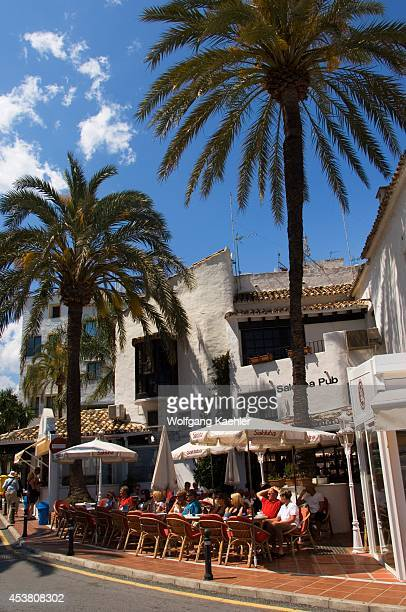 Spain Costa Del Sol Marbella Puerto Banus Street Scene With Cafe/restaurant