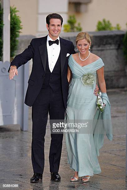 Crown Prince Pavlos of Greece and USborn Crown Princess MarieChantal pose for photographers as they arrive to an official diner at the Pardo Palace...