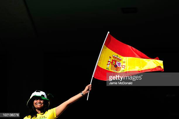 Spain fan flies her national flag as she enjoys the atmosphere prior to the 2010 FIFA World Cup South Africa Group H match between Spain and...