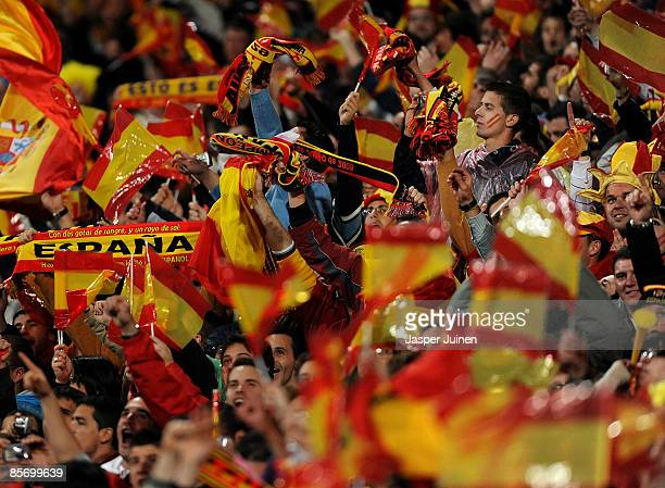 Spain fans cheer their team during the FIFA2010 World Cup Qualifier match between Spain and Turkey at the Estadio Santiago Bernabeu on March 28 2009...