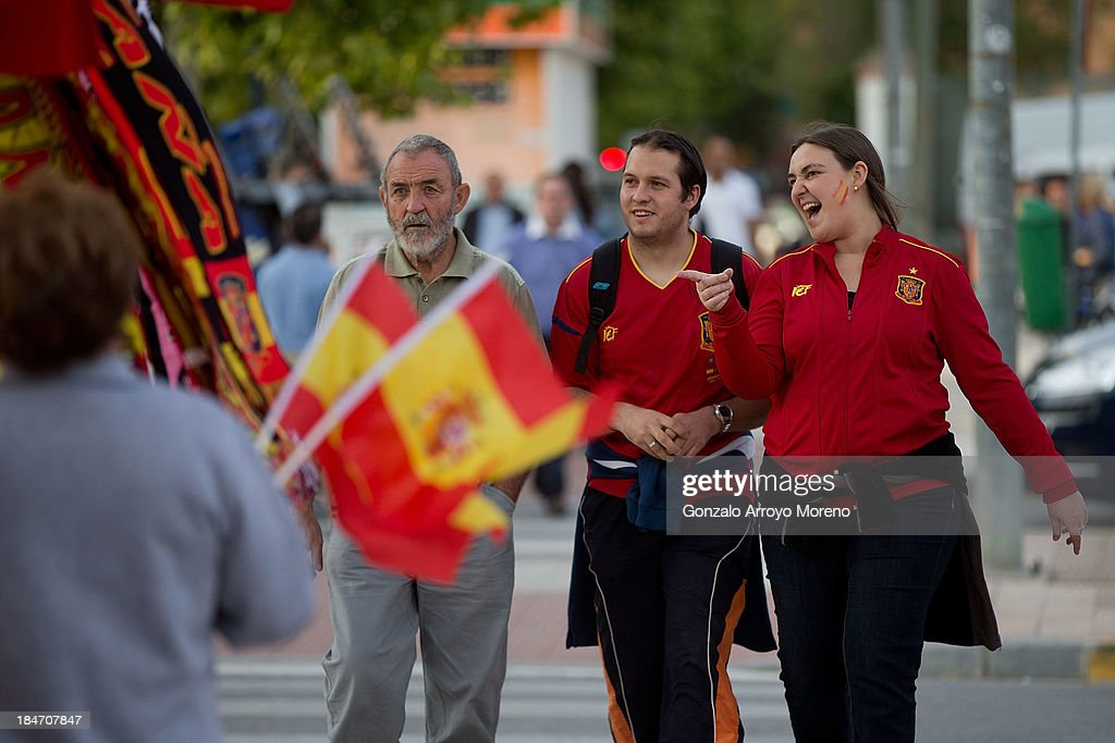 Spain fans laughs as they point to a merchandise stall at Carlos Belmonte stadium outdoors prior to start the FIFA 2014 World Cup Qualifier match between Spain and Georgia on October 15, 2013 in Albacete, Spain.