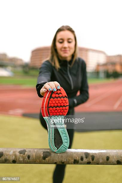 Spain, Female runner worming up for training