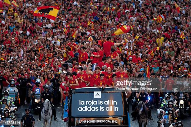 Spain Football team players celebrate with the UEFA EURO 2012 trophy on a doubledecker bus during the Spanish team's victory parade on July 2 2012 in...