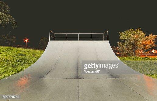 Spain, Galicia, Ferrol, Skatepark at night outdoors