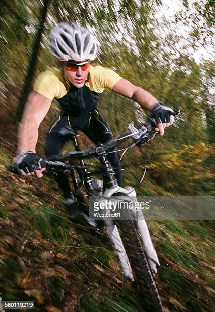 Spain, Galicia, Naron, mountain biker riding downhill