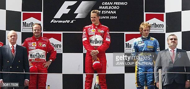 German Ferrari driver Michael Schumacher his Brazilian teammate Rubens Barrichello Italian Renault driver Jarno Trulli and King of Spain Juan Carlos...
