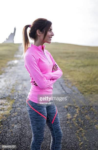 Spain, Gijon, smiling sportive young woman outdoors
