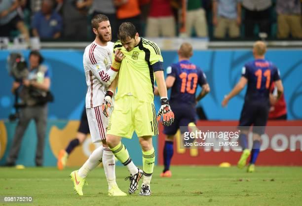 Spain goalkeeper Iker Casillas looks dejected with teammate Sergio Ramos after Netherlands' Robin van Persie scores their fourth goal