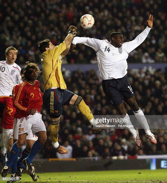 Spain goalkeeper Iker Casillas punches clear from England's Micah Richards during the friendly International match at Old Trafford Manchester
