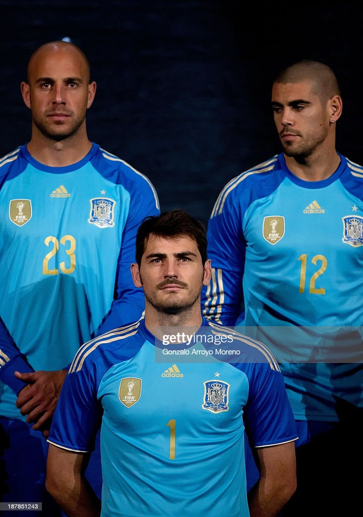 Spain goalkeepers <a gi-track='captionPersonalityLinkClicked' href=/galleries/search?phrase=Iker+Casillas&family=editorial&specificpeople=215446 ng-click='$event.stopPropagation()'>Iker Casillas</a> (2ndL), Pepe Reina (L) and <a gi-track='captionPersonalityLinkClicked' href=/galleries/search?phrase=Victor+Valdes&family=editorial&specificpeople=552392 ng-click='$event.stopPropagation()'>Victor Valdes</a> (R) pose for the Media during the Spanish Football Team Outfits Presentation at Compac Theatre on November 13, 2013 in Madrid, Spain.