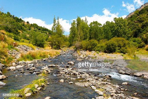 Spain, Granada, Sierra Nevada, River in mountain landscape