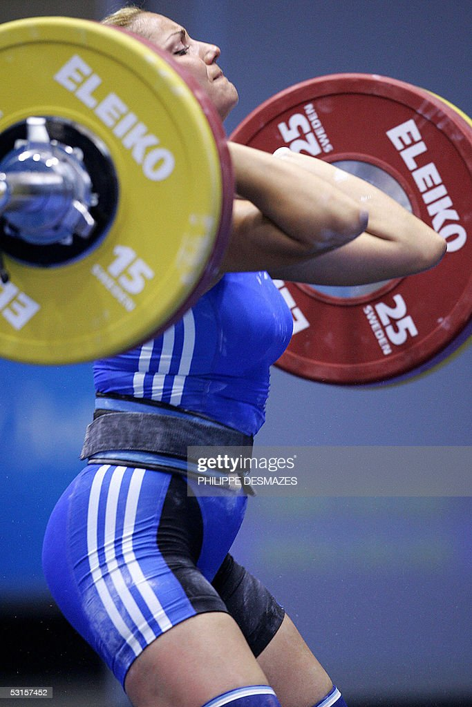 Greek Charikleia Kastritsi performs during women's 58 kg clean and jerk weightlifting event of the XV Mediterranean Games 27 June 2005 at the Youth...