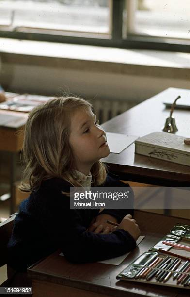 Spain in July 1971 The Infanta Elena 9 years in the classroom sitting at her table schoolgirl with a sheet of paper and colored pencils