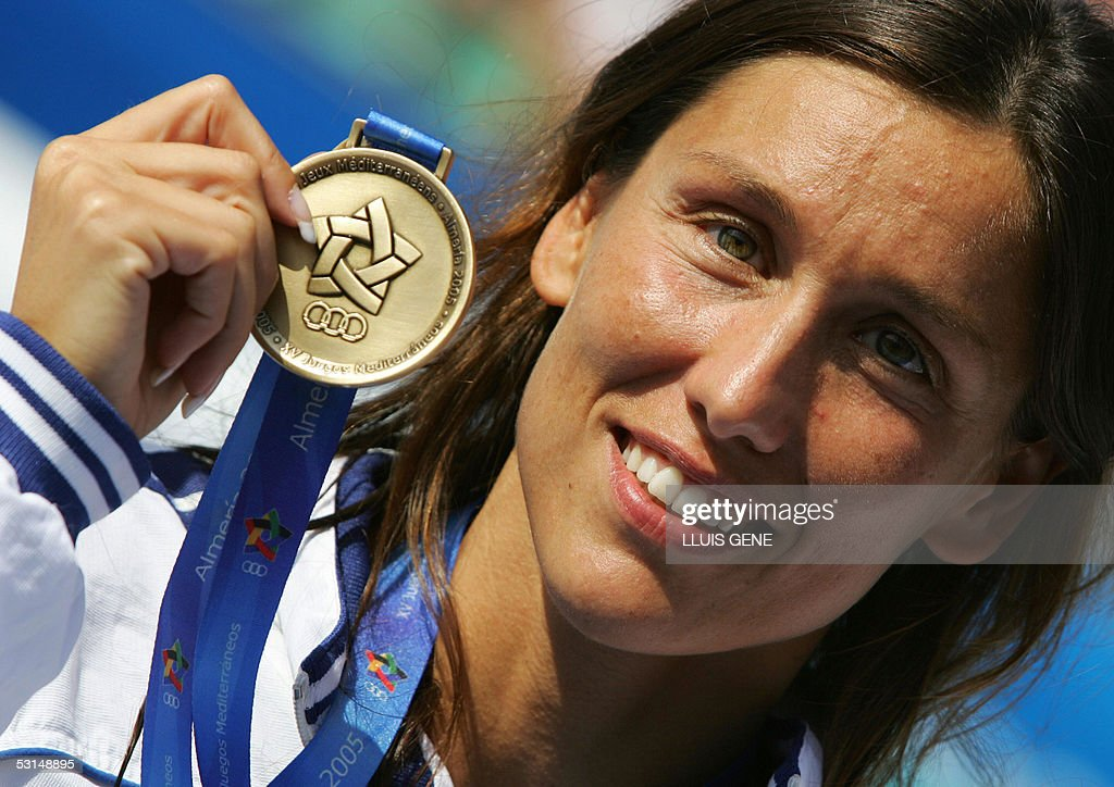 Italian <b>Cristina Chiuso</b> celebrates on the podium after winning women's 50m ... - spain-italian-cristina-chiuso-celebrates-on-the-podium-after-winning-picture-id53148895
