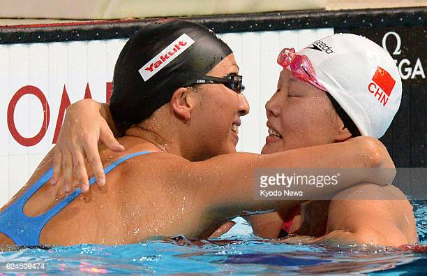 BARCELONA Spain Japan's Aya Terakawa and China's Zhao Jing hug after the final of the women's 50meter backstroke at the world swimming championships...