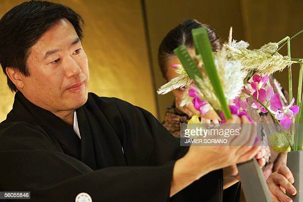 Japan's Kyotaka Kobayashi a master in Ikebana the art of beautifully arranging flowers is seen in action in Madrid with Rikako Yano a teacher of the...