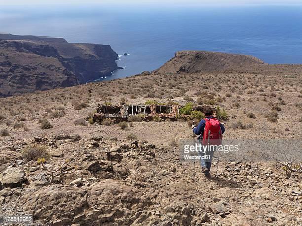 Spain, La Gomera, Woman walking on Las Pilas at Valle Gran Rey