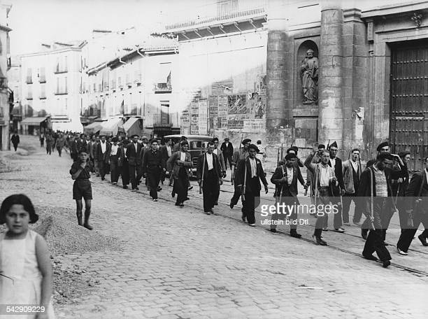 Spain Leon Castile Valladolid Spanish Civil War Volunteers of General Franco's fascist movement marching through the streets of Valladolid to...