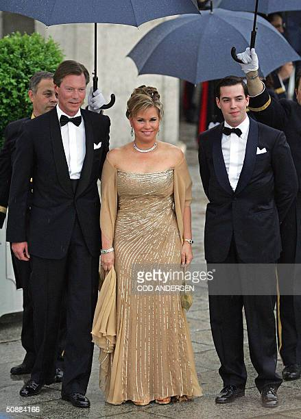 Luxemburg's Grand Duke Henri Grand Duchess MariaTeresa and Crown Grand Duke Guillaume of Luxemburg pose for photographers as they arrive to attend an...