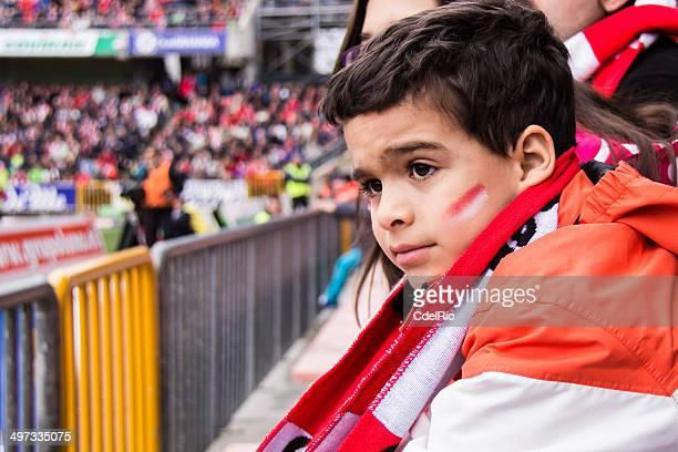 Spain, Madrid, Boy (6-7) at football match