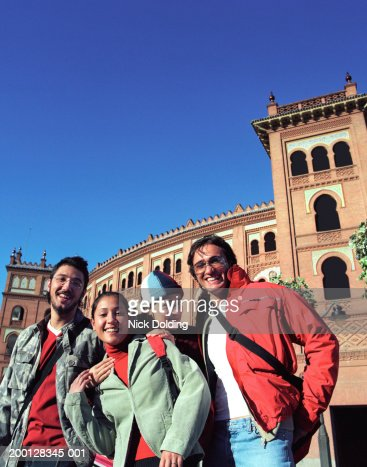 Spain, Madrid, group of friends outside Las Ventas bullring, portrait : Stock Photo