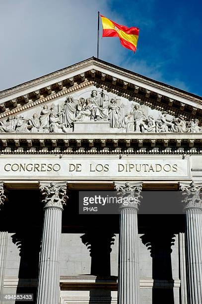 Spain Madrid Pediment of the Congress of Deputies showing Spain embracing the State Constitution and surrounded by Fortitude Justice Fine Arts...