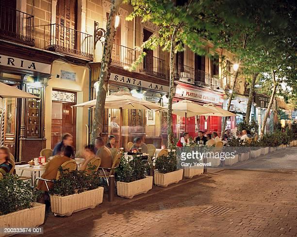 Spain, Madrid, Plaza de Santa Ana, people outside bars and restaurants