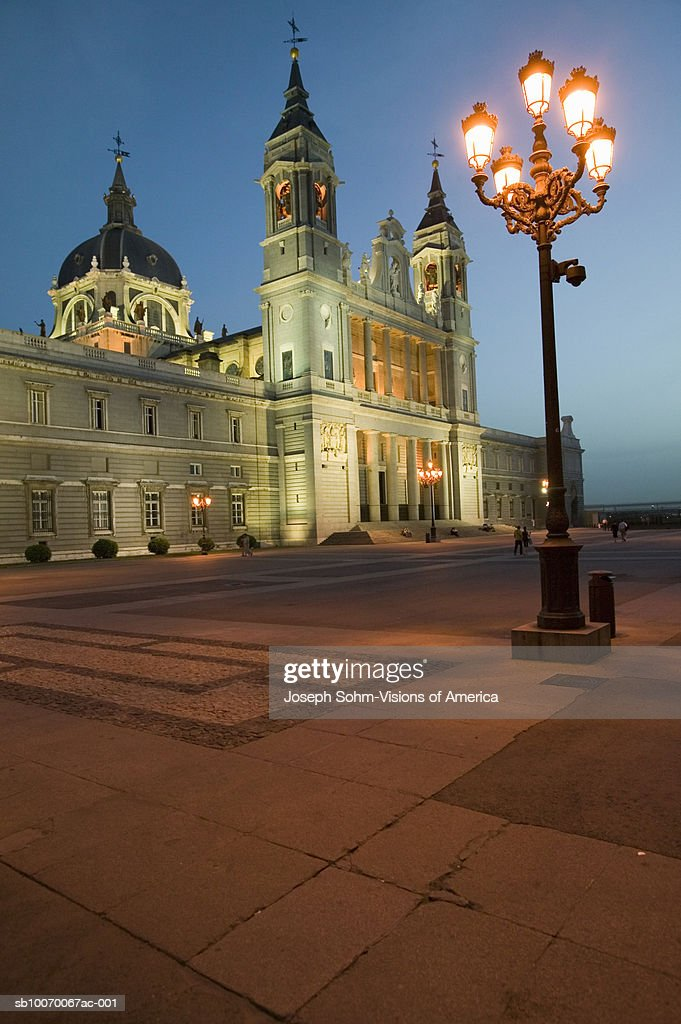 Spain, Madrid, streetlights in front of Royal Palace : Stock Photo