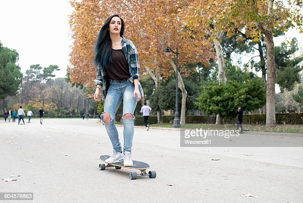 Spain, Madrid, young woman longboarding