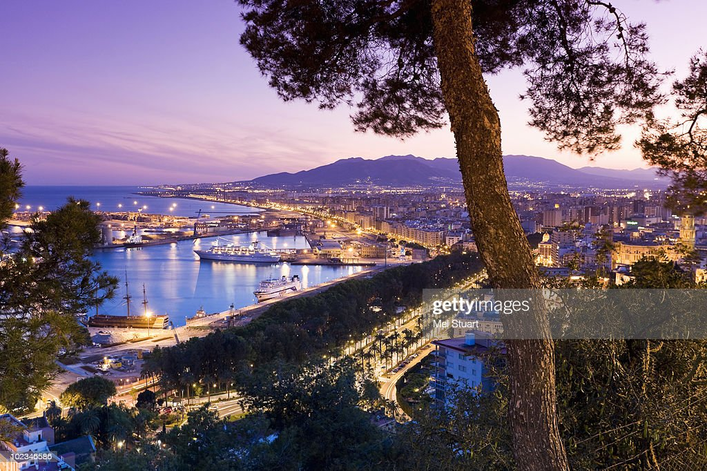 Spain, Malaga, Illuminated port at night