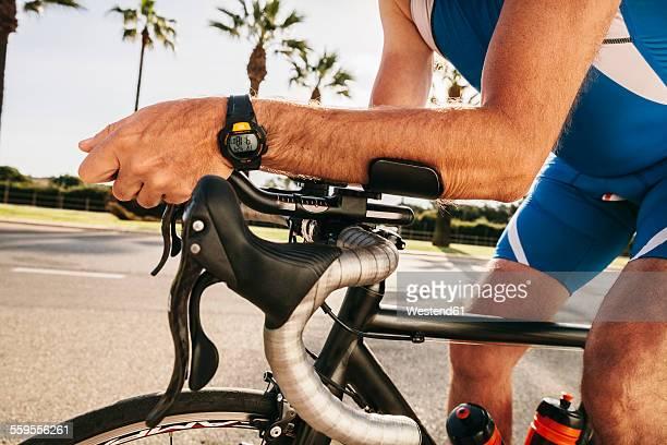 Spain, Mallorca, Sa Coma, triathlet training on bicycle, close-up