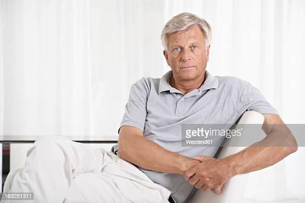 Spain, Mallorca, Sad senior man sitting on couch