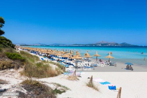 Spain, Mallorca, View of tourists in Playa de Muro beach