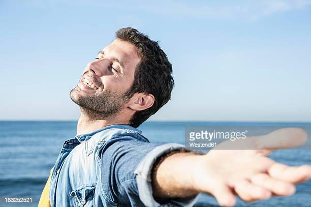 Spain, Mid adult man smiling