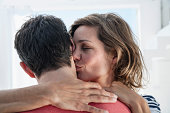 Spain, Mid adult woman kissing to man