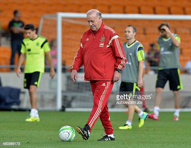 Spain national football team's coach Vicente Del Bosque kicks a ball during a training session at the Soccer City Stadium in Johannesburg on November...