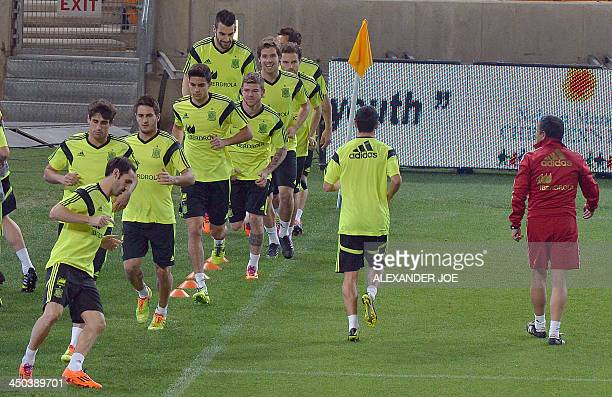 Spain national football team's players take part in a training session at the Soccer City Stadium in Johannesburg on November 18 2013 on the eve of...