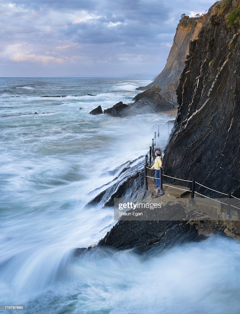 Spain, Ondarroa, sea hitting cliffs : Stock Photo