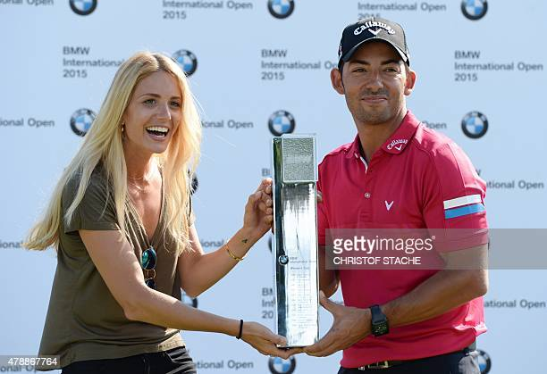 Spain Pablo Larrazabal and his girlfriend Gala Ortin joke with the winner trophy during the winner ceremony of the BMW International Open golf...