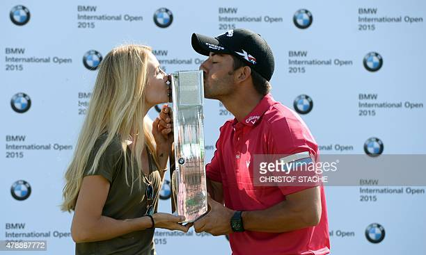Spain Pablo Larrazabal and his girlfriend Gala Ortin kiss the winner trophy during the winner ceremony of the BMW International Open golf tournament...