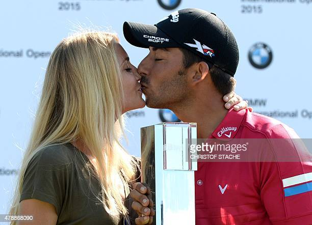 Spain Pablo Larrazabal kisses his girlfriend Gala Ortin during the winner ceremony of the BMW International Open golf tournament in Eichenried near...
