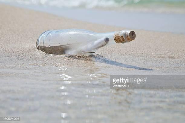 Spain, Palma, Mallorca, Message in bottle at Playa de Palma