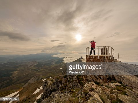 Spain, Pico tres mares, senior man photographing at observation point