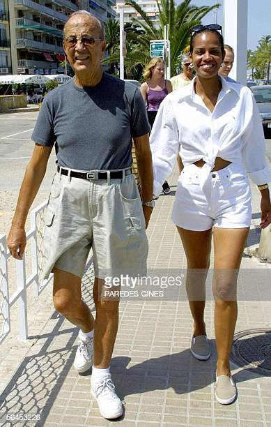 Picture taken in the summer of 2002 shows Spanish doctor Julio Iglesias Puga father of famous singer Julio Iglesias and his wife Ronna Keitt walking...